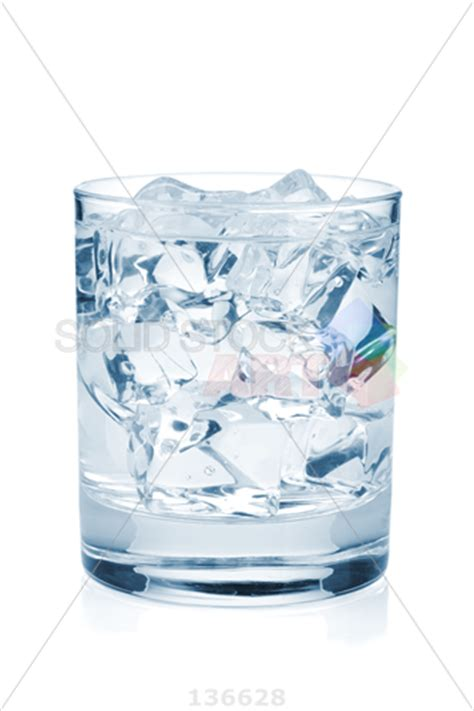 Stock Photo of Small glass filled with water and ice cubes