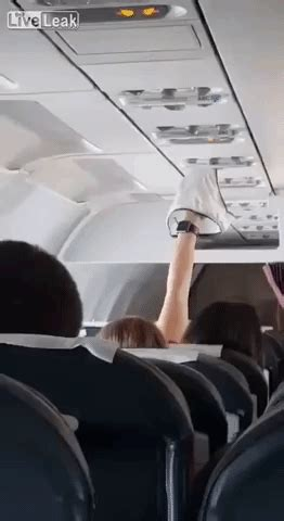 Video Shows A Woman Using Plane's Overhead Air Vent To Dry