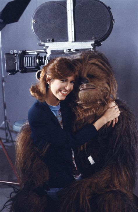 12 Adorable Photos Of Carrie Fisher With Her Awesome Star