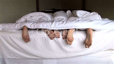 Family Feet in Bed: Royalty-free video and stock footage